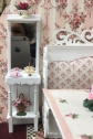 Suzanne Harrington-Cole created this shabby chic shelf.