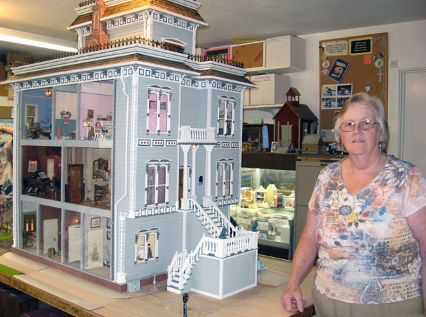 Margie Wannamaker with her dollhouse