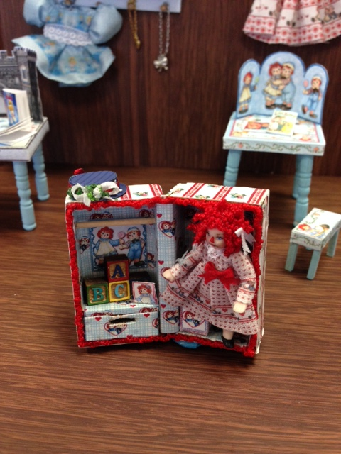 Raggedy Ann in a trunk