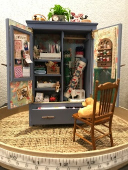 Barbara Adams's 1:12 scale cupboard is full of sewing notions.